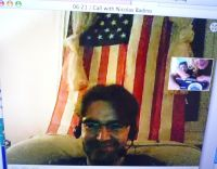 During a videoconference on Inauguration Day, Nicolas, who lives in France, appears with the American flag in the background, shockingly visible from the outside through the window. Note that during all the years he lived in America, Nicolas never publicly displayed his French flag through the window. Brave but not dumb.
